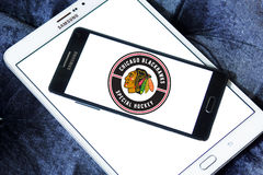 Chicago Blackhawks hockey team logo. Logo of Chicago Blackhawks hockey team on samsung mobile. Chicago Blackhawks are a professional ice hockey team in NHL based royalty free stock photos