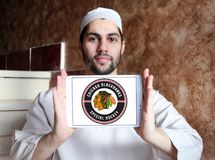 Chicago Blackhawks hockey team logo. Logo of Chicago Blackhawks hockey team on samsung tablet holded by arab muslim man. Chicago Blackhawks are a professional stock images