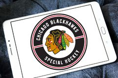 Chicago Blackhawks hockey team logo. Logo of Chicago Blackhawks hockey team on samsung tablet. Chicago Blackhawks are a professional ice hockey team in NHL based royalty free stock images