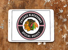 Chicago Blackhawks hockey team logo. Logo of Chicago Blackhawks hockey team on samsung tablet on wooden background. Chicago Blackhawks are a professional ice royalty free stock photography