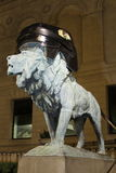 Chicago Blackhawks Lion. Image of Art Institute Lion with Blackhawks hockey helmet stock photography