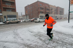 Chicago Blizzard. CHICAGO - FEB 1: A man jogs during a massive winter storm on February 1, 2011 in Chicago. The storm brought as much as 21 inches of snowfall Stock Photography