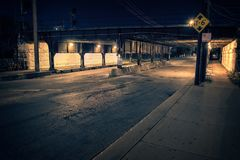 Chicago city alley industrial train bridge underpass at night. Dark Chicago city alley industrial train bridge underpass at night Royalty Free Stock Photography