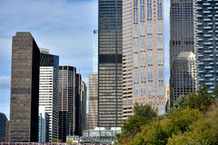 Chicago city buildings beside Chicago River. City and buildings by Chicago river,  Chicago, Illinois, United States Royalty Free Stock Photography