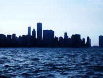 Chicago city downtown urban skyline at dusk with skyscrapers over Lake Michigan with clear blue sky Stock Image