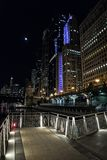 Chicago city riverwalk promenade at night with vintage bridge. Chicago city riverwalk promenade at night with vintage drawbridge, illuminated urban downtown Stock Images