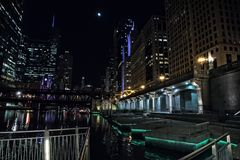 Chicago city riverwalk promenade at night with vintage bridge. Chicago city riverwalk promenade at night with vintage drawbridge, illuminated urban downtown Royalty Free Stock Photography