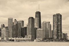 Chicago city urban skyline. Black and white with skyscrapers over Lake Michigan with cloudy blue sky Stock Image