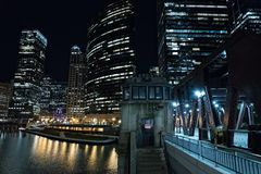 Chicago city vintage river drawbridge at night. Chicago city vintage river drawbridge with elevated CTA subway train and urban downtown buildings at night Stock Photo