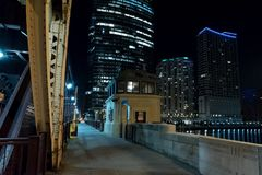 Chicago city vintage river drawbridge with urban buildings. Chicago city vintage river drawbridge with urban downtown buildings at night Stock Photography