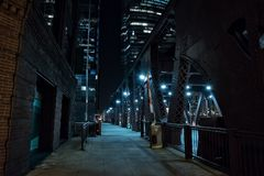 Chicago city vintage river drawbridge at night. Chicago city vintage river drawbridge with urban downtown buildings at night Royalty Free Stock Photos
