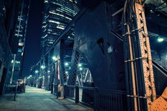 Chicago city vintage river drawbridge at night. Chicago city vintage river drawbridge with urban downtown buildings at night Royalty Free Stock Images