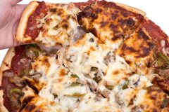 Chicago classic thin crust pizza. Chicago classic thin crust sausage, mushrooms, green peppers and onion pizza Stock Images