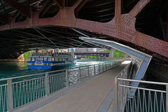 Chicago Cruise Boat under bridge and Riverwalk Royalty Free Stock Photo