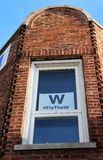 Chicago Cubs Fly the W Sign in a Window. A Chicago Cubs Fly the W Sign is displayed in a window of a Chicago apartment Royalty Free Stock Image