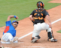 Chicago Cubs Marion Byrd slides into home plate for the go ahead stock image
