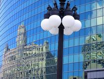 Reflections of architecture in a modern building of Chicago. Chicago: details of a street lamp lit.nThis picture was taken in downtown Chicago, near Millennium royalty free stock image