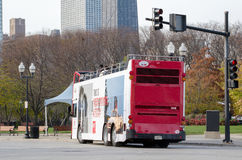 Chicago double decker bus. A red double decker bus leaves Navy pier, to head back into the city. Popular with tourists, these busses let you ride throughout  the Royalty Free Stock Photos