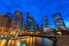 Chicago downtown and Chicago River at night in Chicago, Illinois stock photography