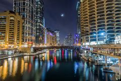Chicago downtown by the river at night stock photo
