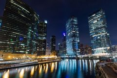 Chicago downtown  illuminated view by the river Royalty Free Stock Image