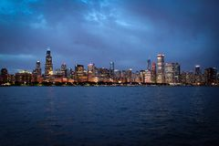 Chicago downtown and Michigan Lake panoramic view, Illinois, USA. Chicago downtown and Michigan Lake embankment panoramic view with skyscrapers by sunset Royalty Free Stock Photography