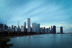 Chicago downtown and Michigan Lake panoramic view, Illinois, USA. Chicago downtown and Michigan Lake embankment panoramic view with skyscrapers by sunset Stock Photos