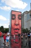 Chicago Downtown: Millennium Park Crown Fountain. Chicago Downtown, Millennium Park with people playing in water coming from the fountain during the summer time stock photography