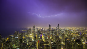 Chicago downtown night panorama with thunders Stock Photos