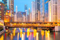 Chicago downtown and River. City of Chicago downtown and River with bridges at dusk Stock Photos