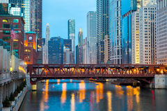 Chicago downtown and River. City of Chicago downtown and River with bridges at dusk Royalty Free Stock Photos