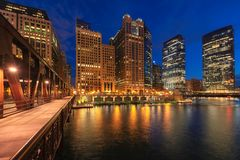 Chicago downtown and Chicago River at night in Chicago, Illinois royalty free stock image