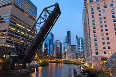 Chicago downtown riverside. Image of the Chicago downtown area and a old drawbridge at twilight Stock Images