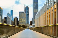 Chicago downtown skyline in the evening seen from pedestrian bridge Nichols Bridgeway royalty free stock photography