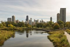 Chicago downtown skyline. Chicago skyline partially reflected in a Lincoln Park lagoon Stock Photography