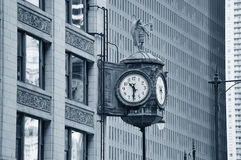 Chicago downtown street view. With old fashion clock and skyscraper building in black and white Royalty Free Stock Images