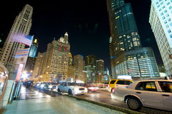 Chicago Evening Traffic and city life. Evening Traffic on Michigan Avenue at the Chicago River. City life Stock Photos