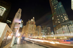 Chicago Evening Traffic and city life. Evening Traffic on Michigan Avenue at the Chicago River. City life Royalty Free Stock Photos