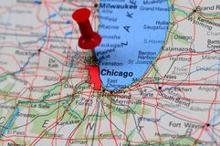 Chicago financial center. City of Chicago highlighted with a push pin on an atlas or map Royalty Free Stock Image