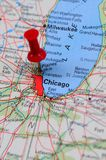 Chicago financial center. City of Chicago highlighted with a push pin on an atlas or map Stock Image