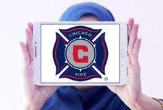 Chicago Fire Soccer Club logo. Logo of Chicago Fire Soccer Club on samsung tablet holded by arab muslim woman. Chicago Fire Soccer Club is an American Stock Photos