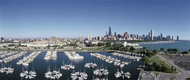 Chicago harbor with skyline on Lake Michigan. This is an aerial view of the Shedd Aquarium, Chicago Harbor and the skyline on Lake Michigan during summer. Boats Stock Photo
