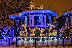 Chicago house with Christmas lights. A neighborhood house in Chicago displaying Christmas lights and snow royalty free stock images