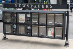 CHICAGO, IL - JULY 11, 2014: Newspaper stand. royalty free stock images