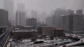 Snow falling in Chicago`s West Loop with views of traffic. CHICAGO, IL-November 10, 2017. Snowfall in the West Loop neighborhood. Traffic moves cautiously along