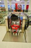 A shopping cart conveyor escalator in a Target store in Chicago. CHICAGO, IL -31 OCT 2018- View of a shopping cart conveyor escalator bringing carts up and down royalty free stock photo