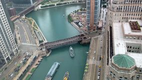 Aerial view of multiple large tour boats causing Chicago River congestion near Wolf Point construction