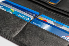 Chicago,IL,USA,Feb-12,2017,Close up of an open wallet with credit cards with Chase,Chase Disney,Citi Simplicity and Master card lo. Gos on white background  for Royalty Free Stock Photos