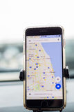 Chicago,IL,USA,Feb-21,2017,Smartphone attached to a car mount in car with Google map for editorial use only. Chicago,IL,USA,Feb-21,2017,Smartphone attached to a Royalty Free Stock Image