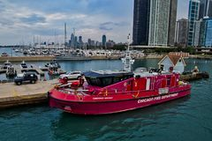 Chicago Fire Department rescue boat docked on Lake Michigan in Chicago, with skyline and boat harbor in background. royalty free stock photos